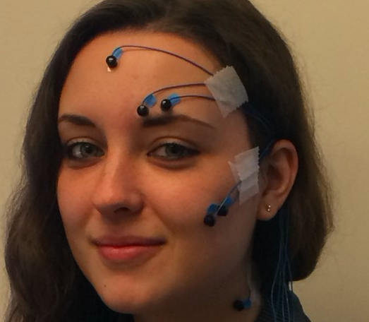 A girl with electrodes on her head