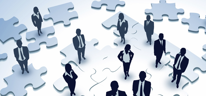 business people on puzzle pieces