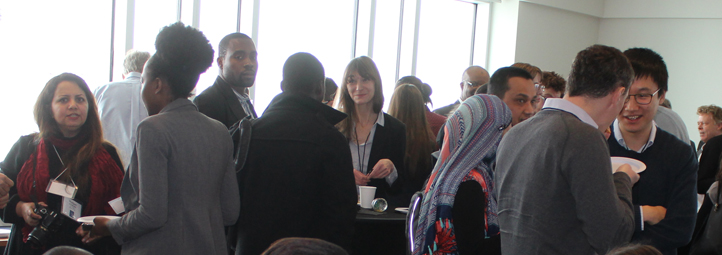 Group of students and professors networking at conference