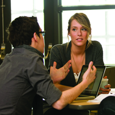 students discussing around a table