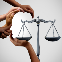 hands around balance of justice forming a face
