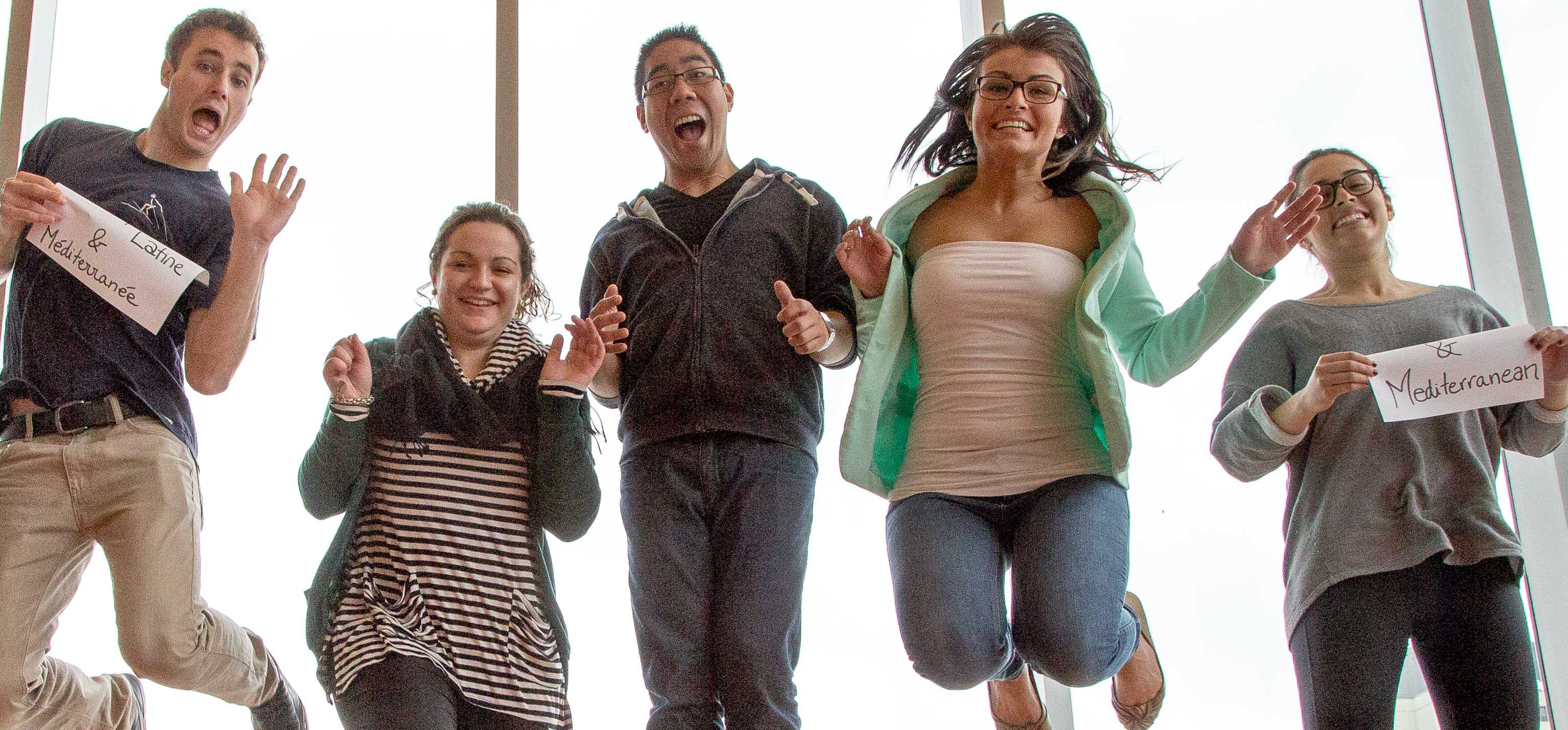group of student jumping for joy