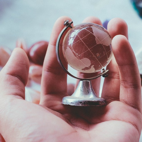 Glass globe in the palm of a hand