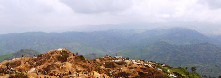 People working in mountainous landscape