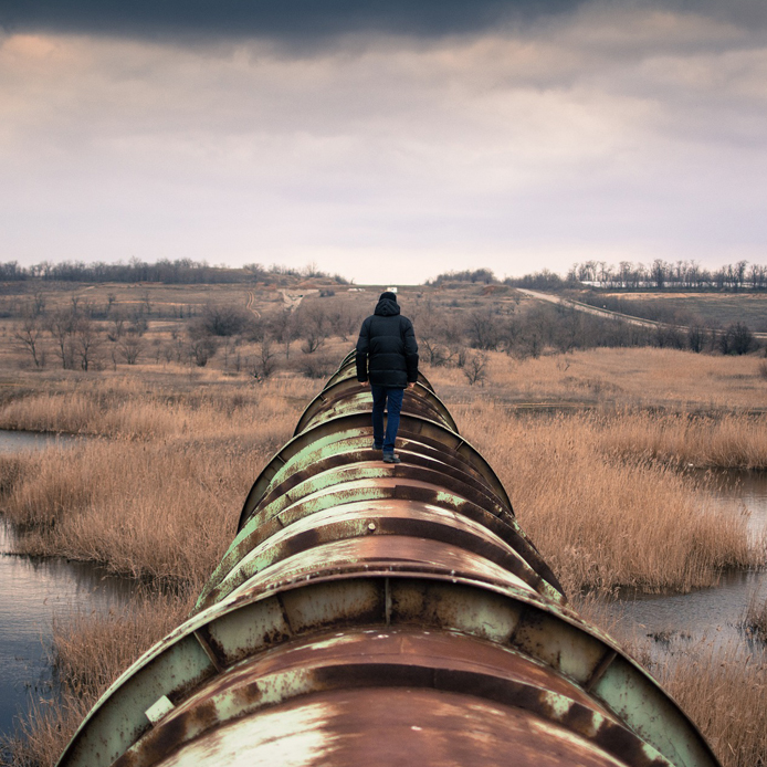 Person standing on pipeline