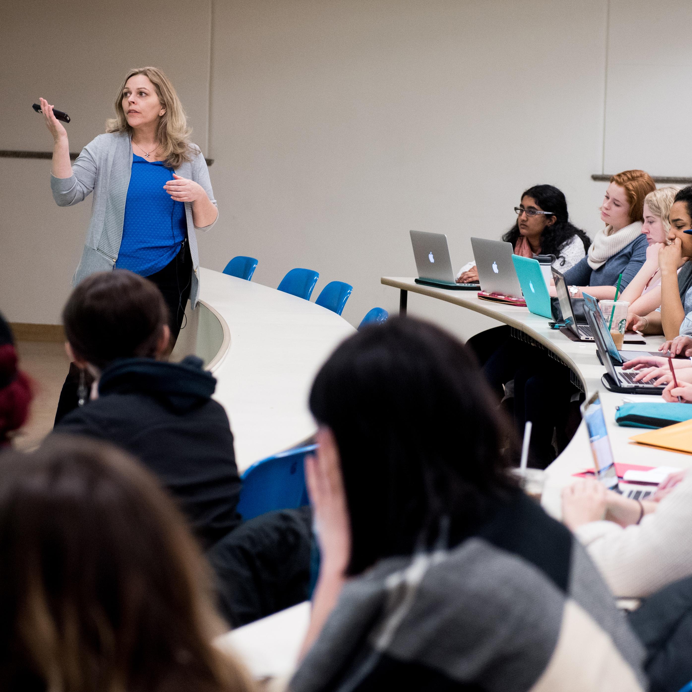 Professor Rebecca Tiessen teaching a class