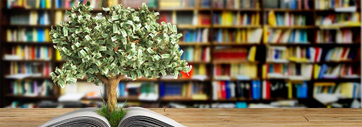 Tree made out of money coming out of a book
