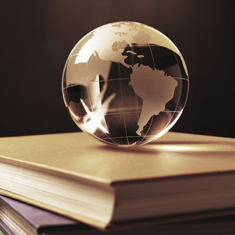 a globe on a pile of books