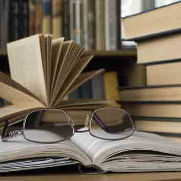 Open book with a pair of eyeglasses on it