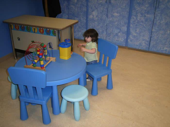 Child playing at the language development lab