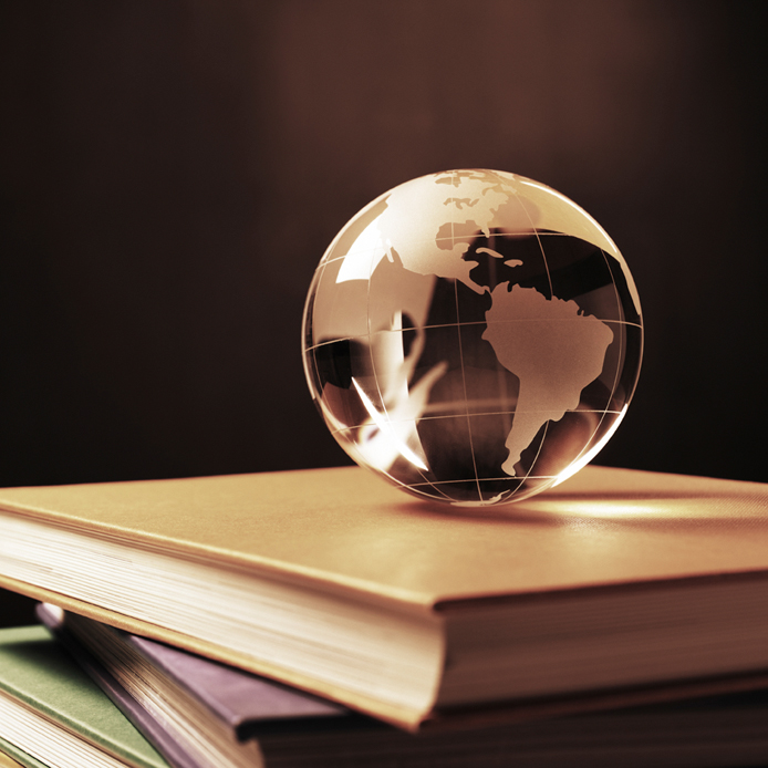 Globe on four books