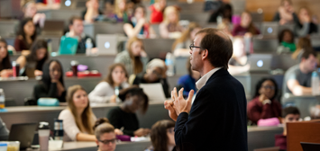 Professor delivering a lecture to students in a classroom