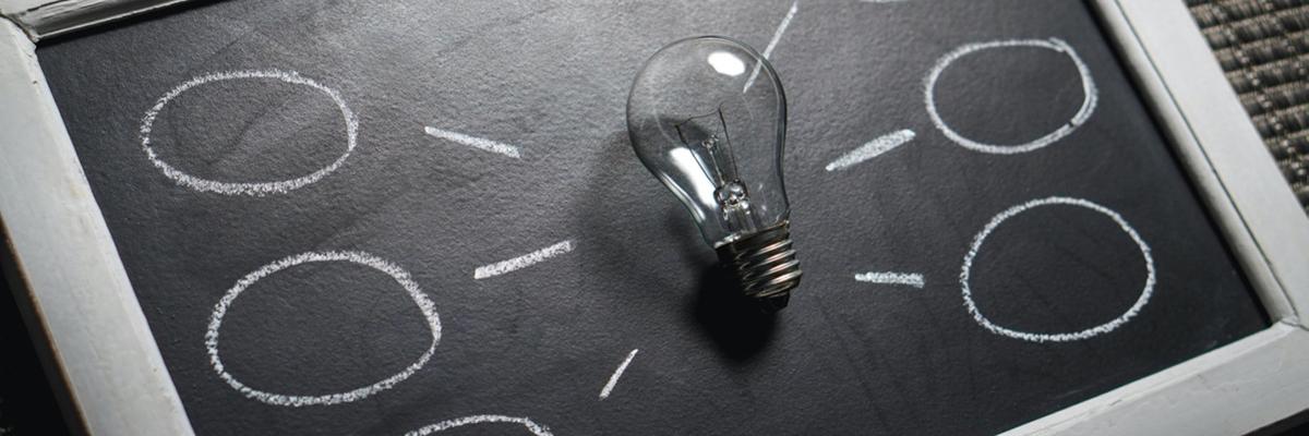 Light bulb on a chalkboard