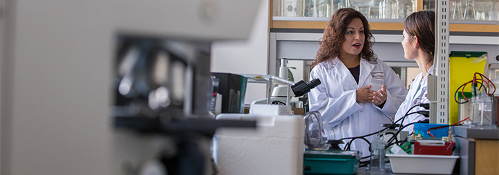 Nafissa Ismail in her lab with a colleague