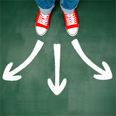 pair of red shoes with three arrows pointing in different directions