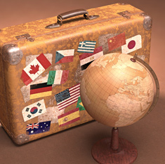 retro suitcase covered in flag stickers with globe