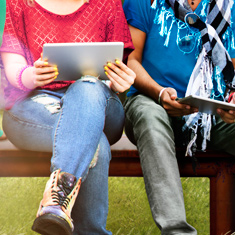 2 people looking at mobile devices