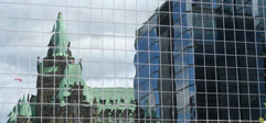 Reflection of the parliament on glass building
