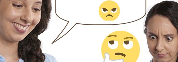 Women texting with emojis