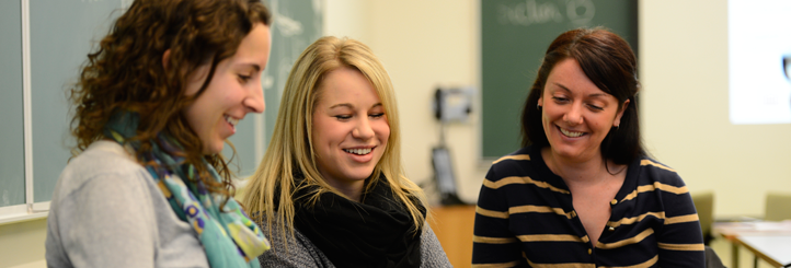 Three students together smiling