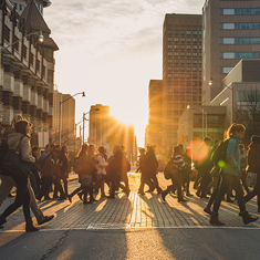 Students crossing the road at sunset.