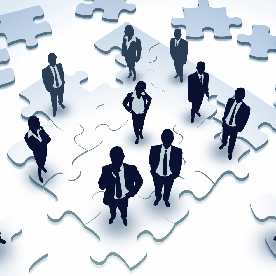 business people standing on puzzle pieces