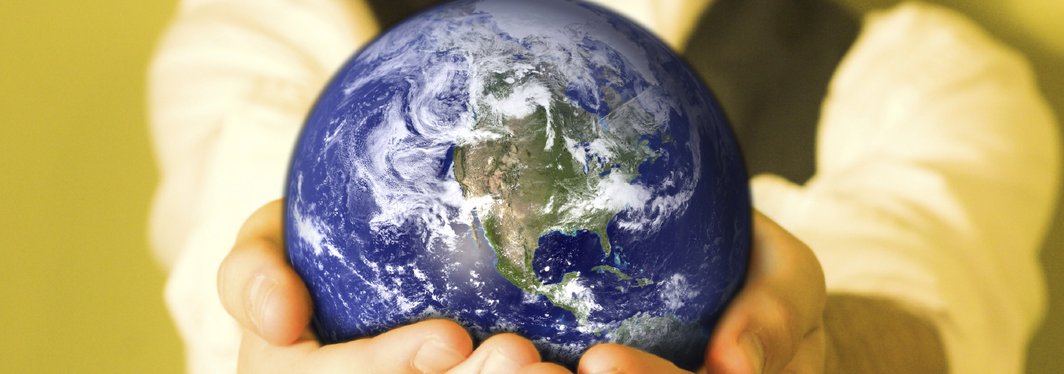 someone holding a globe in their hands