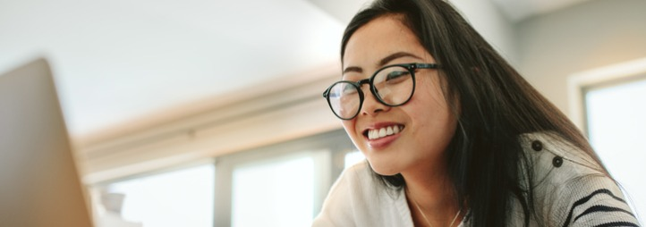 asian woman using laptop at home picture
