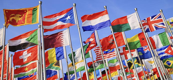 international flags flying on flagpoles