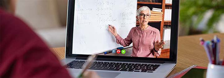 student sitting in front of computer, professor on the screen
