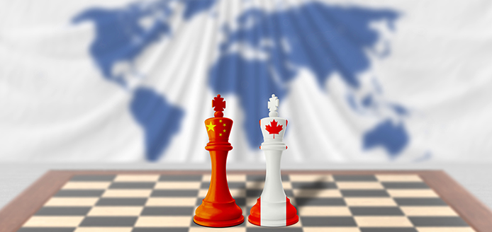Chinese and Canadian chess kings head to head on a chessboard