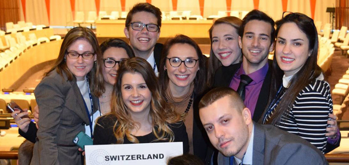 group of students holding a sign with Switzerland