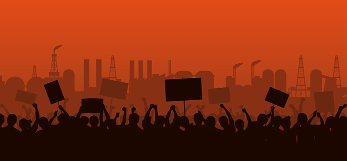 Silhouette group of people with raised fist and protest signs with industrial background