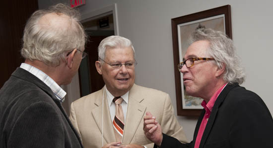 An animated discussion between Michel Chussodovsky, Gordon Boreham, and Serge Coulombe