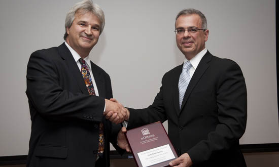 Marcel Mérette, Dean of the Faculty of Social Sciences, congratulates Sam Boutziouvis, winner of the 2010 Alumni of the Year Award.