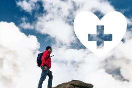 Person climbing up a mountain