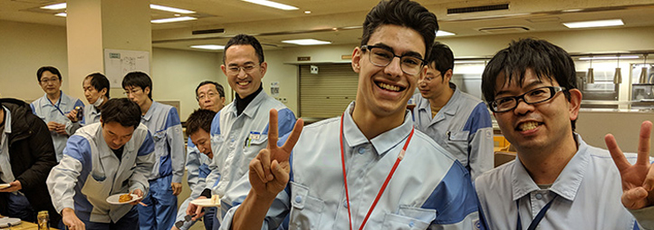 CO-OP student Sheldon Harrison (centre) with colleagues at Dai Nippon Printing Co. Ltd., Chiba, Japan