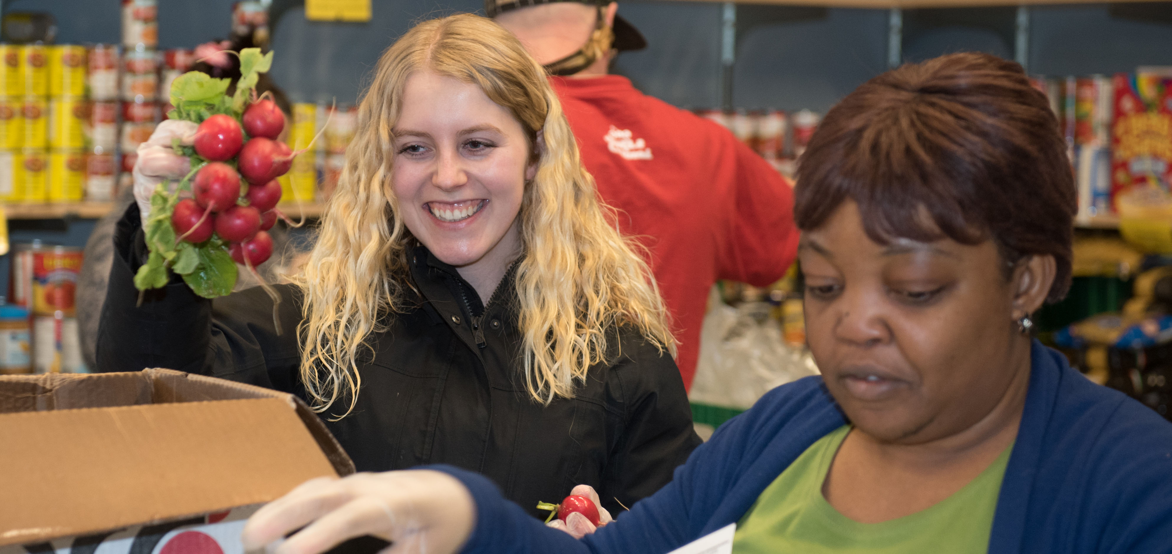 Stacey Wharton and colleague working at a Food Bank