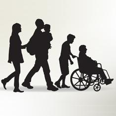 family walking with elderly person in wheel chair