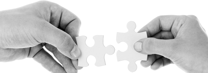 two hands holding a puzzle piece